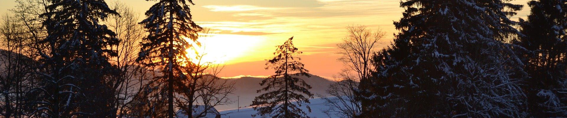 Griesbachhof Slider: Sonnenuntergang im Schwarzwaldwinter